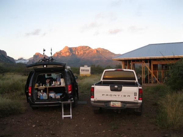 59_cars, house, trailer & mountain morning light
